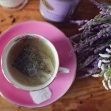 A cup of tea and some herbs